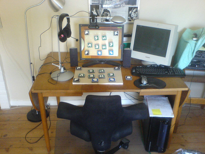 The complete testing setup. Computer, game pieces, camera! Admittedly somewhat awkward to items right in front of you, yet being forced to view a recording of your own hands.